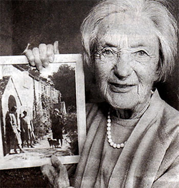 Helen Taylor with a photo of her old home at Tyneham. Photo: Copyright and used with permission of Phil Yeomans BNPS Agency.