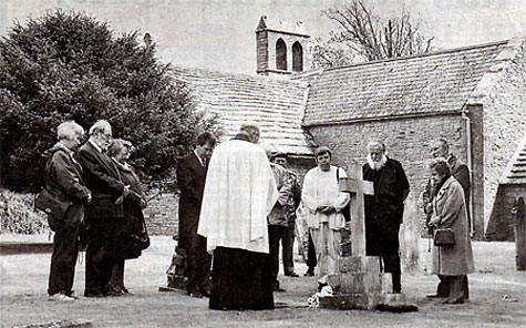 Friends and relatives at Helen Taylor's grave at St. Mary's Church, Tyneham, where in 1943, she left troops a note. Photo copyright and used with permission of Phil Yeomans BNPS Agency.
