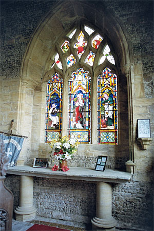 This pointed east window of the chapel is of three lights with curvillinear tracery.