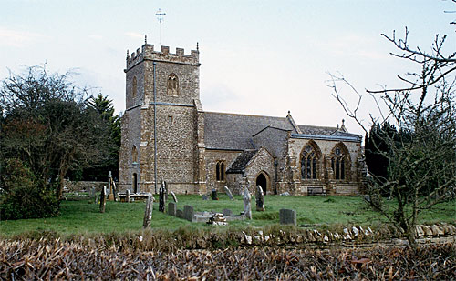 The Parish Church of St Mary stands in a spacious tidy churchyard surrounded by a stone wall.