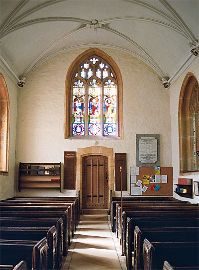 The Nave looking west towards 15th century window and door, which leads to modern vestry.