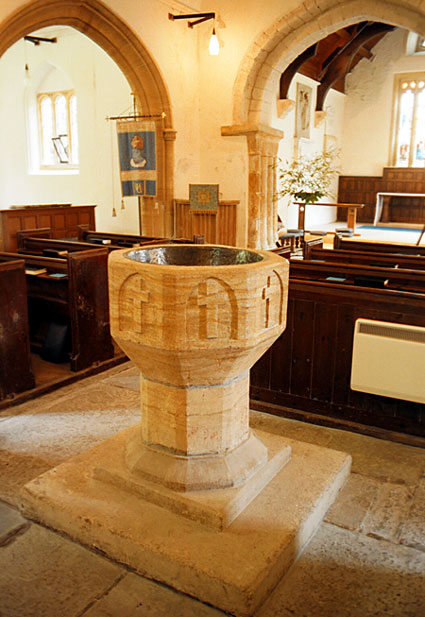 Photo: Font and interior of church