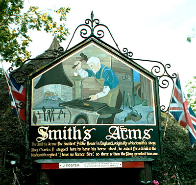 The sign over the entrance to the Smith's Arms at Godmanstone.