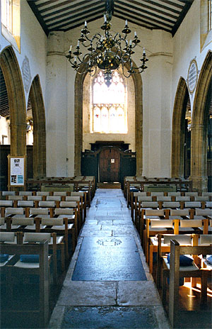 A view inside St. Mary's Church from the chancel screen down the nave, through the tower arch to the main entrance.