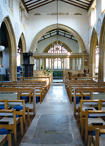 View looking down the nave to the chancel screen and the east window.