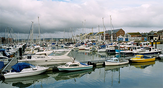 A view of The Marina in the upper reaches of the harbour as it tucks in around Melcombe Regis. It is home to some of the smaller craft moored at Weymouth.