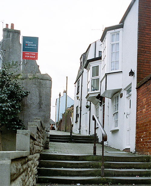 Two flights of steps help you get started on the gentle climb up Love Lane to Franchise Street.