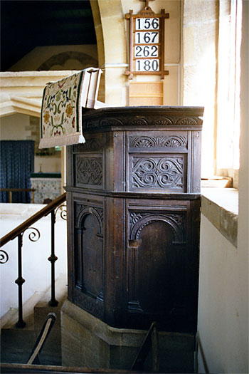 Th oak moulded and carved pulpit is probably 16th century.