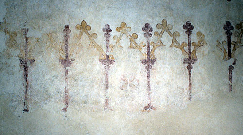Wall painted arcading on the north wall of the nave, west of the entrance. Early 14th century.
