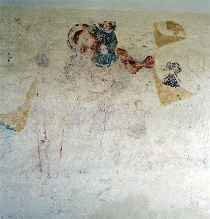 Wall painting on the north wall of the nave east of entrance. St. Christopher with a child on his shoulder and a mermaid in the background. 15th Century.