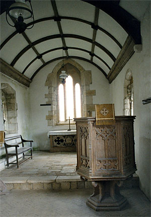 Interior from the nave looking towards the chancel. The east window is restored - originally 13th century.