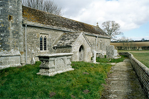 The churchyard is partly surrounded by an 18th century boundary wall.