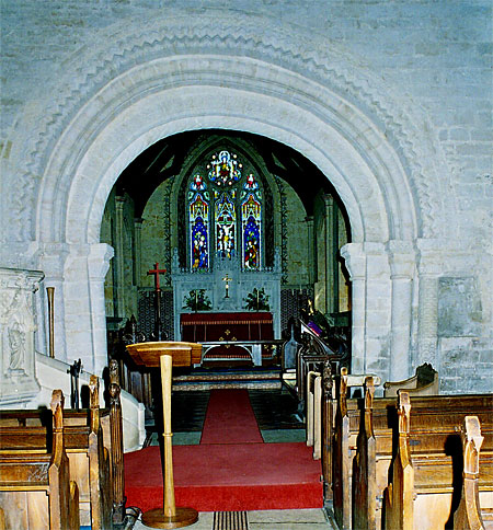 "The lop-sided chancel arch. ""It is the most elaborate Norman chancel arch in any Dorset parish church"" says Pevsner."