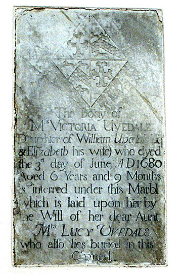 Memorial found in the north wall of the chancel.