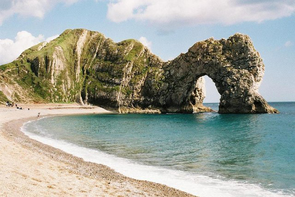 Looking like a resting dinosaur is Durdle Door on Dorset's Jurassic Coast. Photo by Chris Downer. For more information abut the photographer click on the photo.