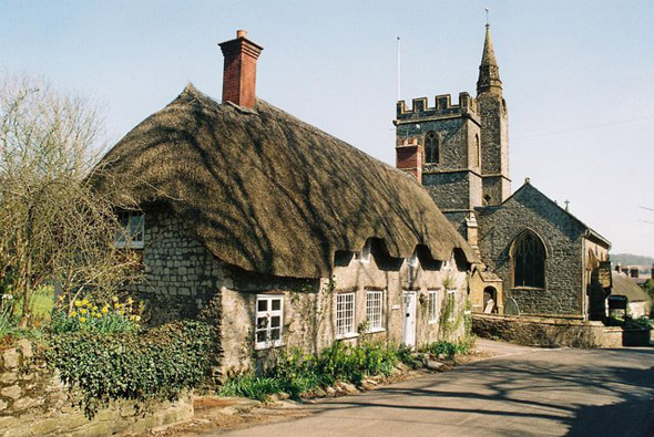 Tess Cottage and Church at Evershot. Photo by Chris Downer, for more about Chris Downer please click on the image.
