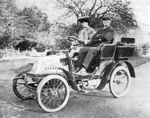 We believe this is a photo of Edwin and Jane Childs with one of his hire fleet.
