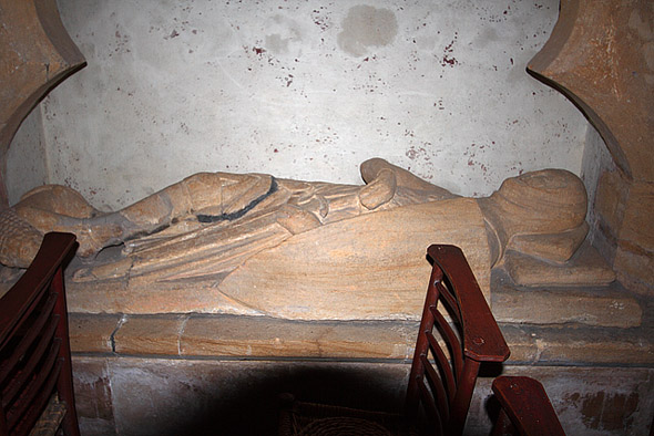 Crusader Effigy Church of St Barnabas - Stock Gaylard. C13 effigy in the south wall of the nave, believed to be the crusader knight Sir Ingelramus de Waleys, whose dismembered body was assumed to have been brought back from the Holy Land for burial in his native place. Certainly a dismembered skeleton was found here during the church's restoration in 1884, and was subsequently re-buried in a new wooden coffin bearing the red cross of the Knights Templar. Photo by Mike Searle, for more about the photographer please click on the image.