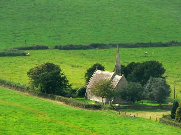 A distant view of the church at North Poorton. See our article in the North Poorton Category. Photo by Chris Downer, for more about the photographer click on the image.